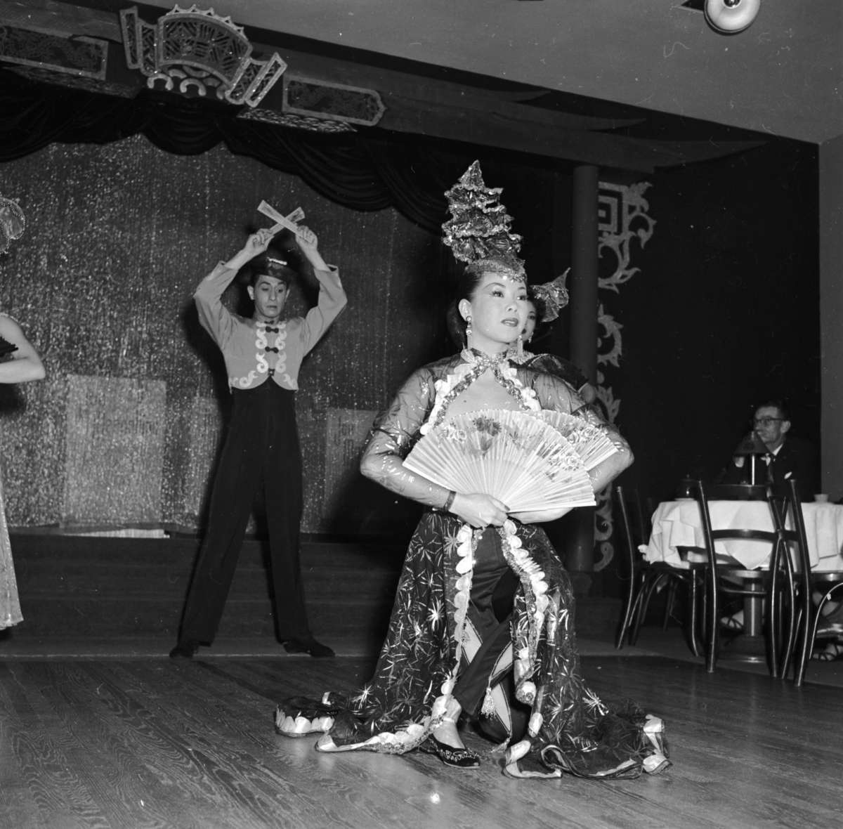 Chinese dancers Mae Tai Sing and Tony Wing perform an elaborate floor show circa 1955 at Forbidden City, a nightclub in Chinatown, San Francisco.