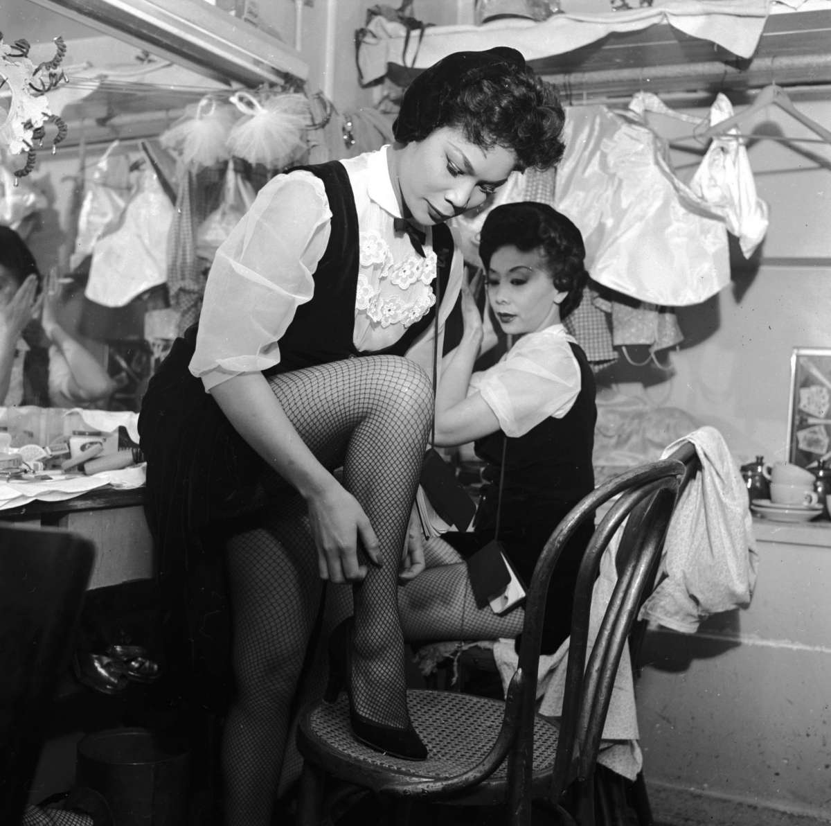 Two chorus girls prepare for their act in the dressing room of the Forbidden City nightclub circa 1955 in Chinatown, San Francisco.