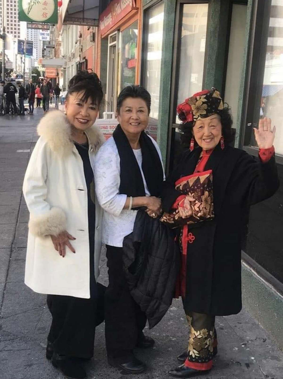 """From left to right: Patricia Nishimoto (a member of the Grant Avenue Follies), Shari Matsuura (Coby Yee's daughter) and Coby Yee in Chinatown, taken in 2019. """"Coby loved seeing me in her white leather coat,"""" said Nishimoto."""